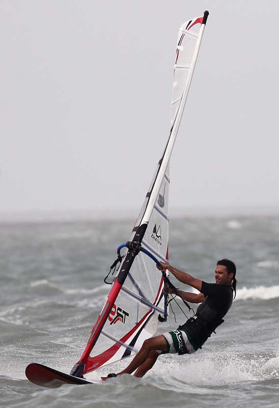 Windsurfer windsurfing, an image in Texas Aquatic Science by author Rudolph Rosen