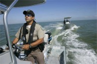Conservation officer or Game Warden, an image in Texas Aquatic Ecosystem Science by author Rudolph Rosen