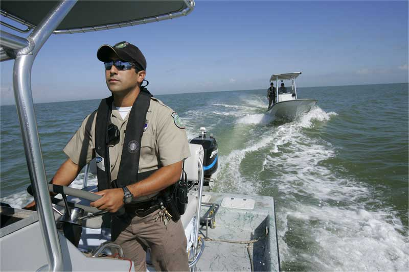 Fish and wildlife conservation officer or Game Warden, an image from Working and Careers in Water and Aquatic Science from the book Texas Aquatic Ecosystem Science by author Rudolph Rosen.