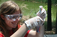 student testing water quality, an image in Texas Aquatic Science by author Rudolph Rosen