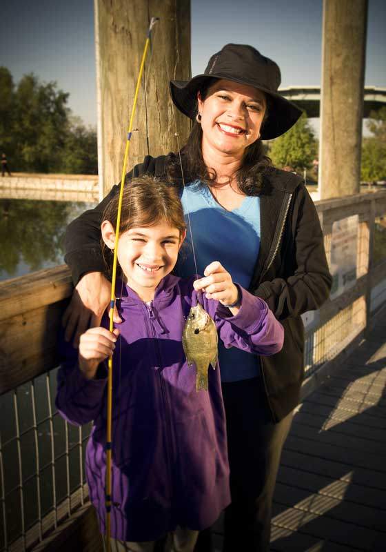 Girl fishing with mother, an image in Texas Aquatic Science by author Rudolph Rosen
